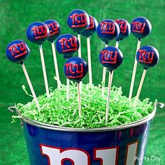 Show your team spirit with team logo cake pops! Click the image for how-to & more football party food ideas.