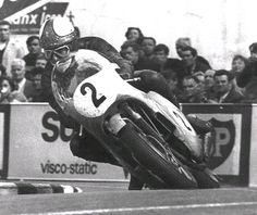 Notice the bike's lean angle which are greater than the foot clearance, - rider is wearing through the leather on his boots so far that he will grind his toes on the road, with bloody results, - and, - he will spin the rear wheel out of corners.  This of course is Mike Hailwood on an MV at the 1966 Isle of Man TT.  A very clean riding style where you tuck in rather than hang out, - very graceful and a joy to watch in action.