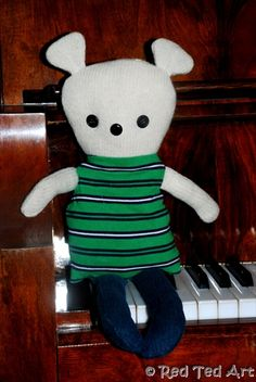 Here's a variation on the Black Apple Doll pattern: add ears and widen legs to make a teddy bear!  This one is a keepsake made with outgrown baby clothes.