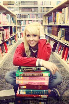 Senior pictures in the library.