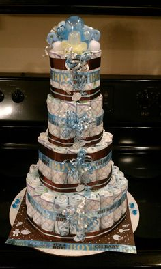 A boys 4 layer diaper cake LIKE Diaper Cakes By T Sparks on facebook