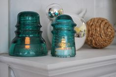 glass insulator decor - use them with battery operated tea lights
