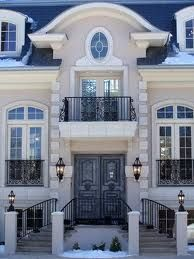 I LOVE this. beautiful balconies. I want a French style home.