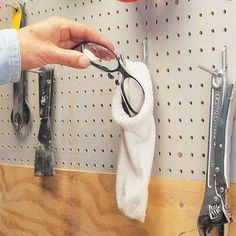 PROTECT SAFETY GLASSES -  The Family Handyman DIY Tip of the Day: Safety Glasses Holder. Protect safety glasses by storing them in an old sock. Hang the sock on the wall in your workshop, and they'll remain scratch-free, dust-free and easy to find.