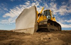 Operate heavy construction equipment