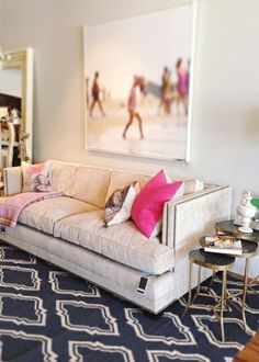 Designed by Alice Lane Home Collection, a cheery sitting area is anchored by a Surya Fallon rug. (FAL-1050)
