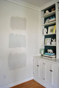 Here's a great blog post on how you have to put the color onto several walls, then watch it change with the light.  From Going Gray | Young House Love