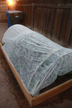 What a great idea!  A simple, cheap and effective way to protect raised beds from frost and freeze!