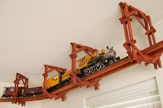 No space on the floor for a train set? No problem — this ceiling-mounted trestle brings train-watching to a new level, and stays clear of your dog and your Roomba. I think that most boys would love to have this in their room! baby boy rooms ideas train, kids trains ceiling, boys bedroom train, train tracks, kid bedrooms, train room for boys, ceilings, babi, train rooms