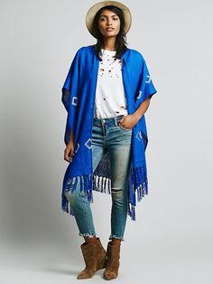 Make a statement in this cobalt fringe shawl.