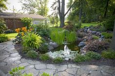 Flagstone patio with backyard koi pond.