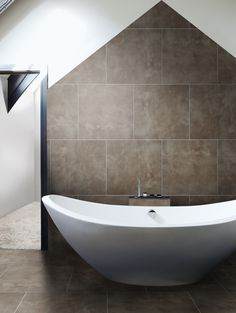 London Mayfair Porcelain. Our London Range has already generated much interest and admiration. With a choice of six on-trend colours, the finish imitates the look of polished concrete. http://www.mandarinstone.com/product/_/568/london-mayfair/ #mandarinstone #inspiration #flooring #featurewall #bathroom #ensuit #porcelain