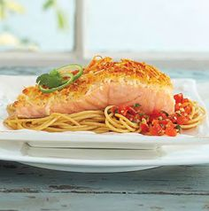 There's a whole lot of good stuff happening with this Parmesan-Crusted Salmon with Angel Hair Pasta and Roasted Red Pepper Salsa recipe. The salmon has a light Parmesan cheese coating on it and we're crazy for the roasted red pepper salsa served on the side. So much flavor!