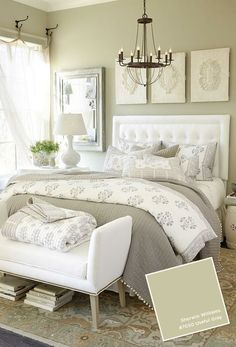 Though the text indicates 'gray' as the predominant colour in this bedroom scheme, we would veer toward taupe or straw with grey as a secondary colour in the accompanying textiles however .... complementary soft white is in no doubt and pretty accessories with a dash of black in the form of the chandelier for contrast produce a restful, contemporary scheme.
