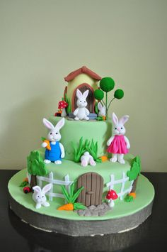 Make rabbits like Peter, Lily, & Benjamin. Blue middle layer with fence or clouds. More veggies. Watering can or flower pot on top.