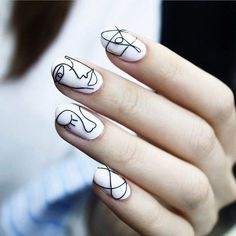 Unexpected nail design captured at a backstage show — Black and white Picasso inspired