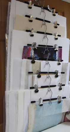 Paper Storage. How clever!  This hangs on the back of the studio door.