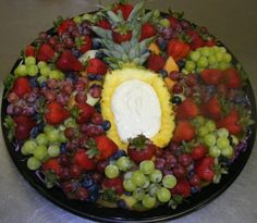 fruit platter idea, though I would definitely cut up the other half of pineapple and put it in there. Maybe some cheese strips, too. MMMMM! ...