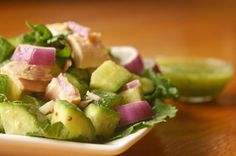 Tuna cucumber salad. Use smaller Persian cukes if you can find them. They have a sweet taste and no bitter seeds. Drizzle with garlic-cucumber-cilantro dressing. Recipe from The Fast Metabolism Diet for Phase 2. #FastMetabolismDiet