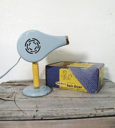 vintage powder blue hair dryer.  Isn't this like moms?  Hers is green though!