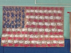 American flag using childrens' handprints for our Veterans Day assembly.