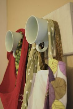 Hang up your aprons on teacups!  CUTE little DIY project for your kitchen. (loveit!)