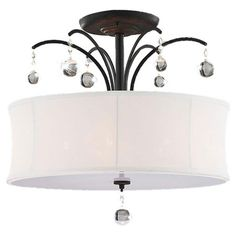 Illuminate your dining room or foyer with this elegant pendant, showcasing a cinched shade and crystal accents.   Product: Pendant