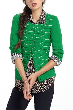 Black & white top + green sweater OR flowered tunic + green sweater + black skinny trousers