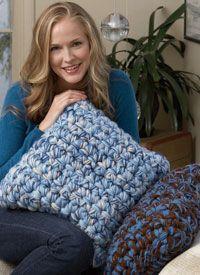 This crochet pillow looks cozy.  Crochet Pillow Pattern: Instant Decor Pillows