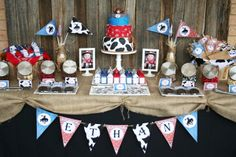 Main table. Love burlap table cover, sign in blue, red bandana & cow print.