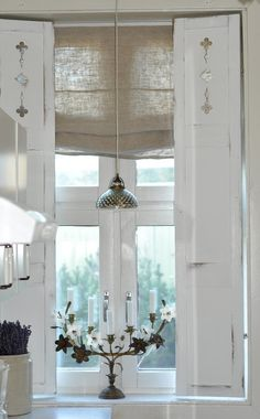 Vintage chic-vintage shutters and burlap Roman shade