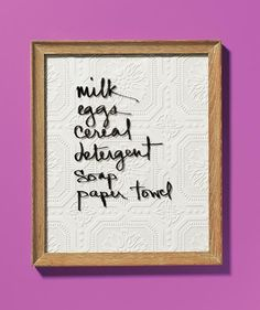 Eye-catching DIY memo board: Frame a pretty scrap of fabric or wallpaper, hang in a high traffic area, and use a dry-erase market to jot down reminders on the glass. via @realsimple