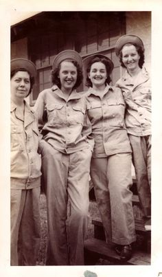Four Army Nurses wearing male pattern HBTs and Daisy-Mae hats. Notice that three of them have the first pattern HBT sets ~
