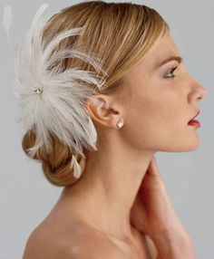 Updo with feather or flower