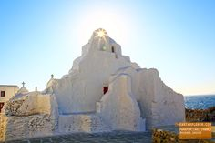 In Mykonos, almost all buildings are white washed. It's used to reflect  sunlight keeping them cool.