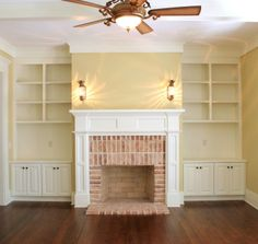 Living room built-ins. Shelving and cabinets on both sides of fireplace.    http://www.cottagehomedecorating.com/images/built-ins-01.jpg