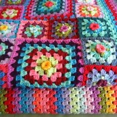 A tutorial for a gorgeous, multi-colored, multi-size granny square blanket.
