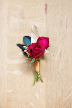 rose #boutonniere done right - photo by Julie Wilhite Photography, flowers by Sweet Magnolia Floral Studio http://ruffledblog.com/roaring-romance-wedding-inspiration/