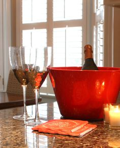 This red bucket and glitzy wine glasses are a perfect pairing for any holiday party