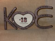 "Custom Horseshoe monogram sign with 4"" x 6"" heart picture frame by Bar 18 Creations. Made to order with your initials and can be custom stamped with a date, names, or phrase. Handcrafted in the U.S.A."