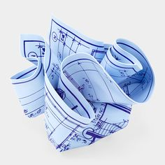 architect's blueprint paper weight....they have legal pad and music sheet ones too...this website has some pretty cool stuff...
