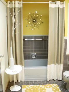 Advertisement  Color Complements    If you think you can't live without your bathroom tile, try decorating in a coordinating color. RMS user mstupski infused this gray-tiled room with yellow and brought it back to life on a budget. Sunny acces… more  You Might Also Like...        link to RMS mstupski yellow and gray bathroom