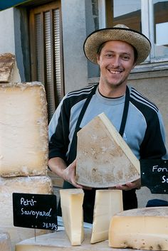 The Cheese Man in Briquebec Market Normandy | he looks a happy chappy