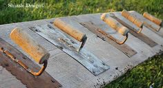 Quirky, cool cement trowel hooks on reclaimed barn wood, by Shizzle Design, featured on http://www.ilovethatjunk.com
