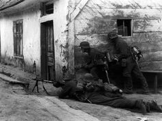 German machine gun element deploys during street fighting in the Battle of Rostov, undated. The battle for Rostov lasted from late Sept 1941 to almost the end of the year. Rostov was the pivot location from which the Germans began their advance upon Stalingrad.