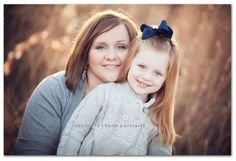 Mother daughter photo.  Cute pose - love the lighting and bokeh background.
