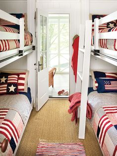 Patriotic Kids Bunkroom ~ A red-white-and-blue theme is perfect for a summer home's bunkroom. With just patriotic bed linens and small area rug, this kids room is playful and filled with color.