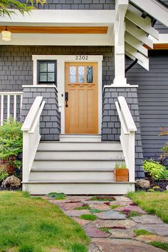 Cedar shake, exposed rafter tails, arts and crafts front door with dentil detail.
