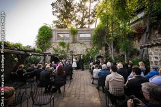 Tarpy's rustic patio is a timeless spot to exchange marriage vows. Wedding Ceremony and Reception Venue: Tarpy's Roadhouse and Monterey Stone Chapel Wedding Photographer: Chris Schmauch, Goodeye Photography+Design