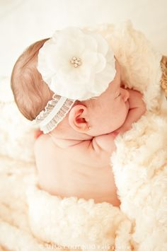 baby girl photo shoot, 1 month old, if we have a girl, it'd be super cute to use the flower I'm wearing for our wedding. :)